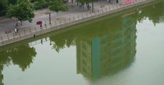 4K China Neighborhood with Building Reflection Stock Footage