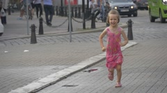 Young Girl Dressed in a Summer Clothes Runing and Playing on City Street Stock Footage