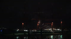 Tall ship Kruzenshtern with big fireworks behind Stock Footage
