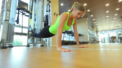 Young attractive woman does core abs crossfit oblique training with fitness trx Stock Footage