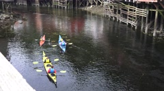 kayaks, tilt up, tourist sight seeing - stock footage