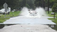 Car Drives Thru Flooded Section Of Road Stock Footage