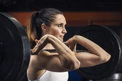 Caucasian athlete lifting weights in gym Stock Photos