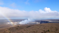 Smoking Kilauea volcano vent with rainbow - stock footage