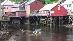 Kayaks, Creek Street establishing , tourist activity touring Stock Footage