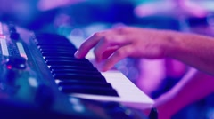 Man's hand playing the electronic piano - stock footage