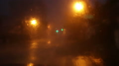 Heavy rain against windshield on a stormy night Stock Footage