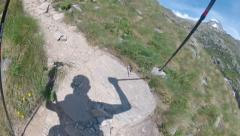 Climber pov ascending rocky path toward Mont Blanc Stock Footage