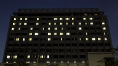 4K Hospital building exterior night, wide establishing shot - stock footage