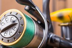 Fishing bait wobbler and reel with line Stock Photos