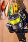 fishing bait wobbler and reel with line - stock photo