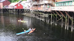 Kayaks, Creek Street, drifting down stream Stock Footage
