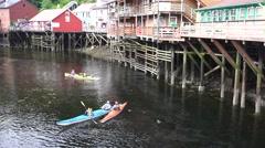 kayaks, Creek Street, drifting down stream - stock footage