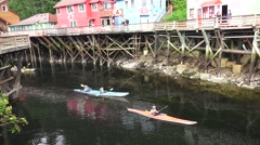 Kayaks, Near Creek Street, pan left Stock Footage