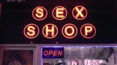4K Sex shop entrance, glowing neon sign,street at night Stock Footage