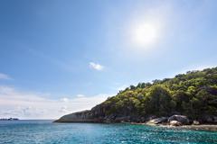Summer sun over the island and sea - stock photo