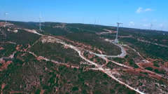 Aerial footage: Flying near wind turbines at the mountainous terrain Stock Footage