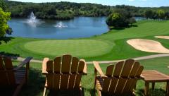 View of Golf Course with Adirondack Chairs Stock Footage