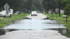 Car Turns Away From Flooded Streets Stock Footage