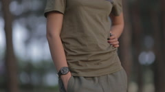 Military pants and a khaki shirt in the forest Stock Footage
