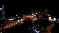 Tianjin at night, city traffic, river, China Stock Footage