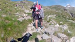 Expedition climbing rocky path toward Mont Blanc Alps higest mountain peak Stock Footage