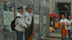 Stock Video Footage of Men with vector military caps and German flag posing for pictures in Berlin