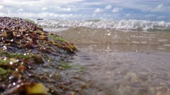 Stock Video Footage of Gentle Waves Over  Beach. Very Low Angle - Camera Partially Submerged