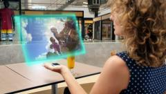 Woman Watching Video on Futuristic Media Device Stock Footage