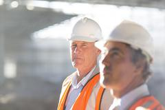 Caucasian architects standing at construction site Stock Photos