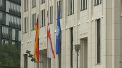 Flags in front of Ritz Carlton, Berlin Stock Footage