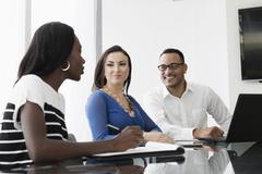 Business people talking in office meeting Stock Photos