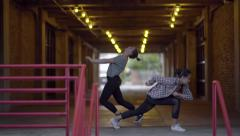Two Dancers Improvise Dance In A Tunnel In the City (Slow Motion) Stock Footage