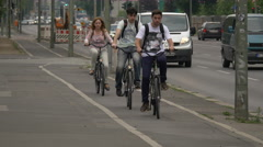 People riding bikes on the bike lane in Berlin Stock Footage