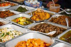 Array of Fresh Foods at a typical eatery in Southeast Asia - stock photo