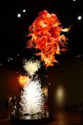 Orange blown glass chandelier - stock photo