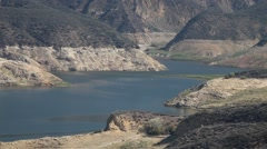 Fire helicopter leaves lake after loading tank (Castaic Warm Fire) V18948 Stock Footage
