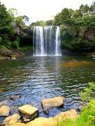 Beautiful waterfall with greenery in New Zealand. - stock photo