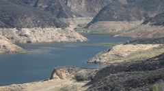 Fire helicopter approaches lake and sucks water Castaic Warm Fire V18954 Stock Footage
