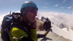 Mountaineers expedition on Grand Paradiso summit on Alps Stock Footage