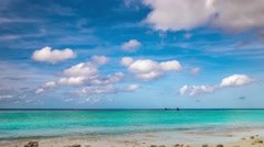 Tropical island beach view with turquoise water and clouds on blue sky. 4K Stock Footage
