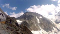 Climber pov from Tete Rousse camp to Coluir on Mont Blanc - stock footage