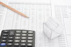 Pencil on finance account have blur bankruptcy house and calculator - stock photo