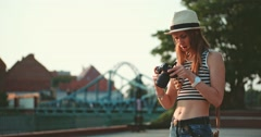 Tourist photographer changing a battery in the camera. Slow Motion. - stock footage