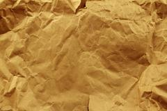 Closeup of brown wrinkled paper texture background - stock photo