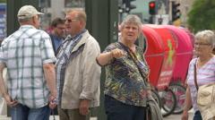 A group of elders talking on the street in Berlin Stock Footage