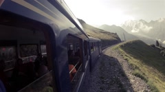 Train takes passengers to Mont Blanc mountaineering expedition climbing route Stock Footage