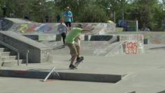 Skateboarder performs a manual and rides on back wheels. Stock Footage