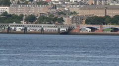 Train crossing Tay Rail Bridge Dundee Scotland Stock Footage