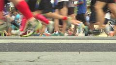 Runners feet runner falls Stock Footage